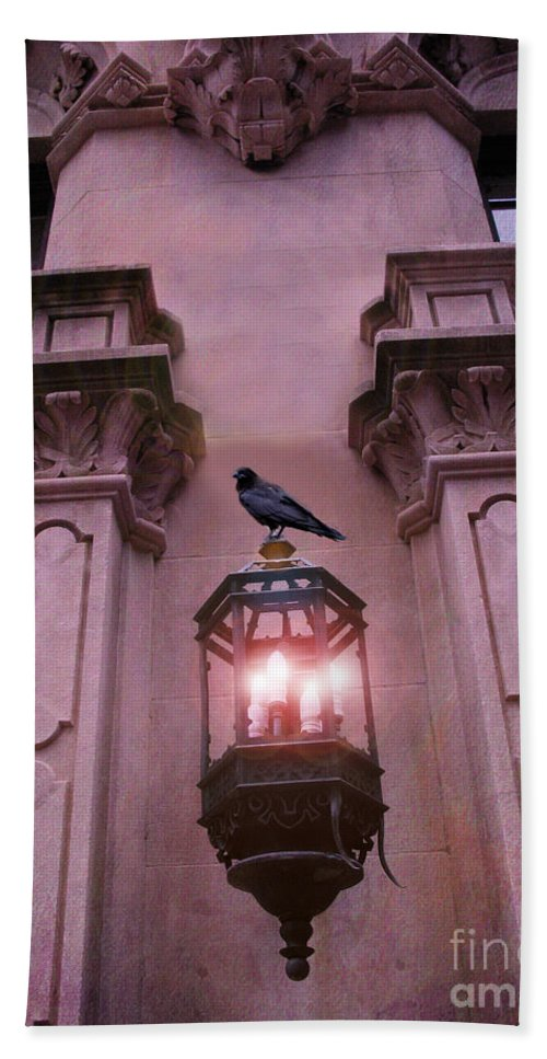 Raven Crow Art Beach Towel featuring the photograph Surreal Raven Gothic Lantern On Building by Kathy Fornal