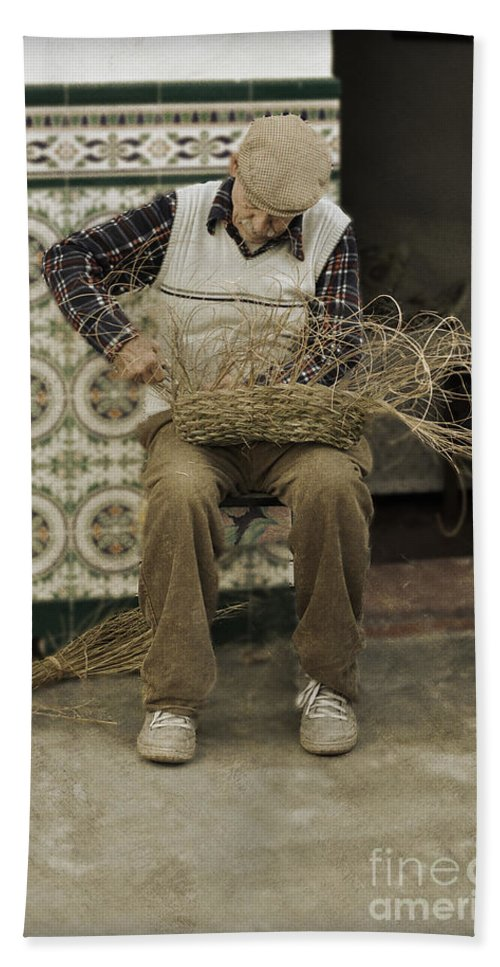 The Basket Maker Beach Towel featuring the photograph The Basket Maker by Mary Machare