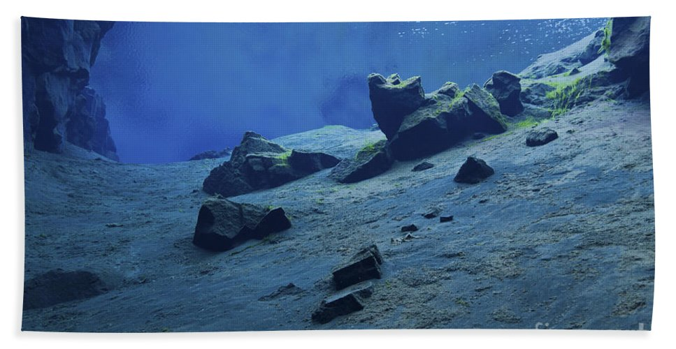 Physical Geography Beach Towel featuring the photograph The Clear Water Of The Lagoon At Silfra by Mathieu Meur