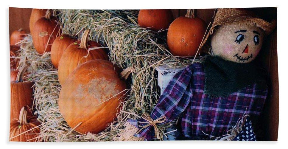 Pumpkin Beach Towel featuring the photograph The Shy Pumpkin-man by John Scates