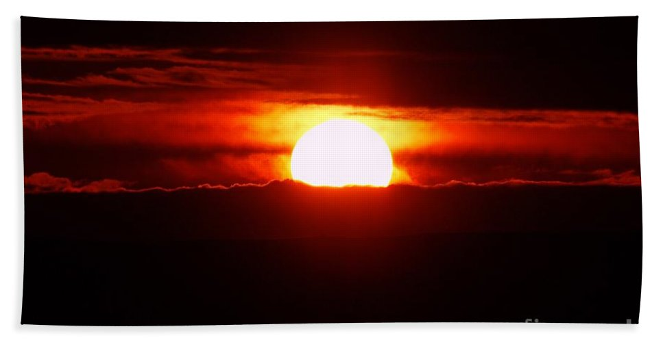 Sun Beach Towel featuring the photograph The Sun Falling Into Clouds by Jeff Swan