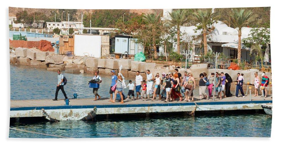 Sharm El Sheikh Beach Towel featuring the photograph Tourists Waiting To Climb Onto Dive And Snorkeling Boats At Sharm El Sheikh by Ashish Agarwal