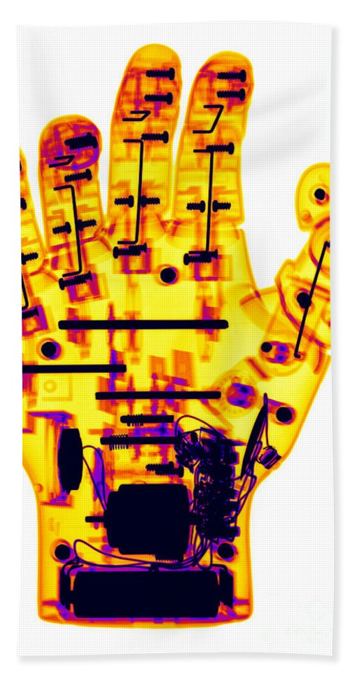 Robot Beach Towel featuring the photograph Toy Robotic Hand X-ray by Ted Kinsman