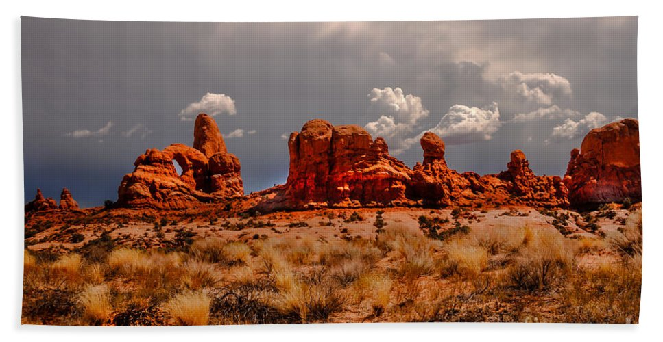 Arches National Park Beach Towel featuring the photograph Turret Arch And Storm Clouds by Robert Bales