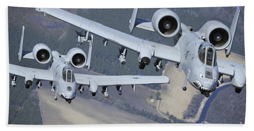 Ground-attack Aircraft Beach Towel featuring the photograph Two A-10c Thunderbolt II Aircraft Fly by Stocktrek Images