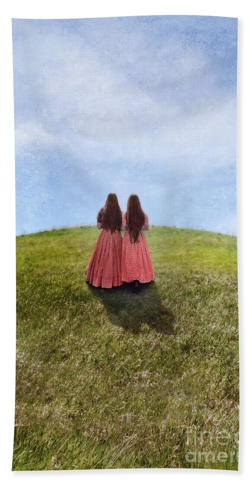 Girl Beach Towel featuring the photograph Two Girls In Vintage Dresses Walking Up Grassy Hill by Jill Battaglia