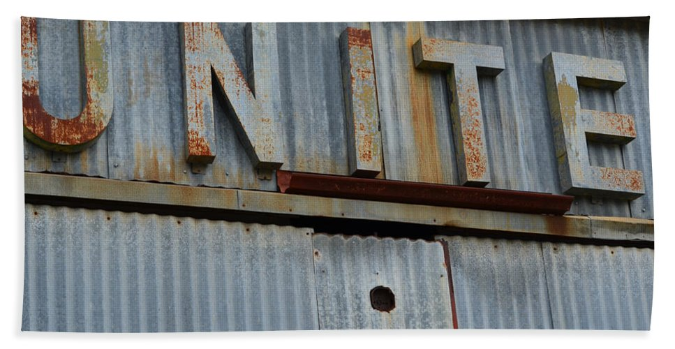 Unite Beach Towel featuring the photograph Unite Weathered Sign by Nikki Marie Smith