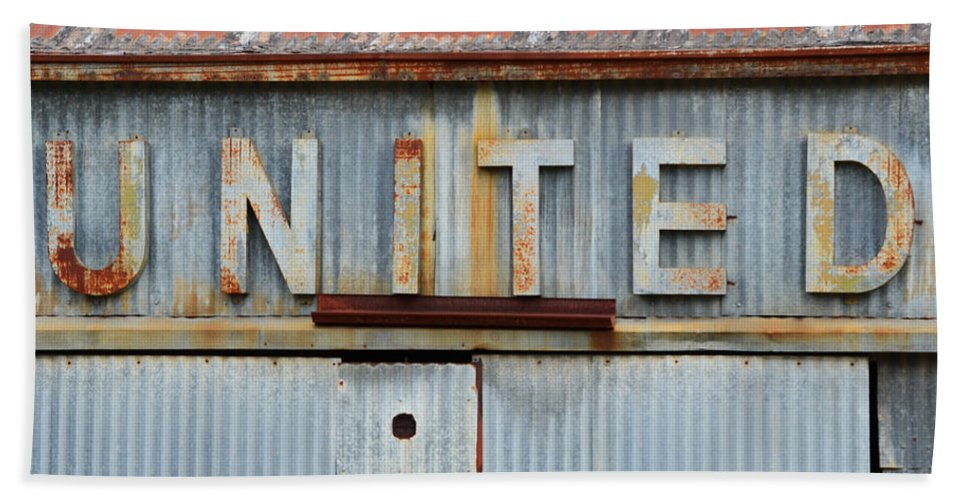 United Beach Towel featuring the photograph United Rusted Metal Sign by Nikki Marie Smith