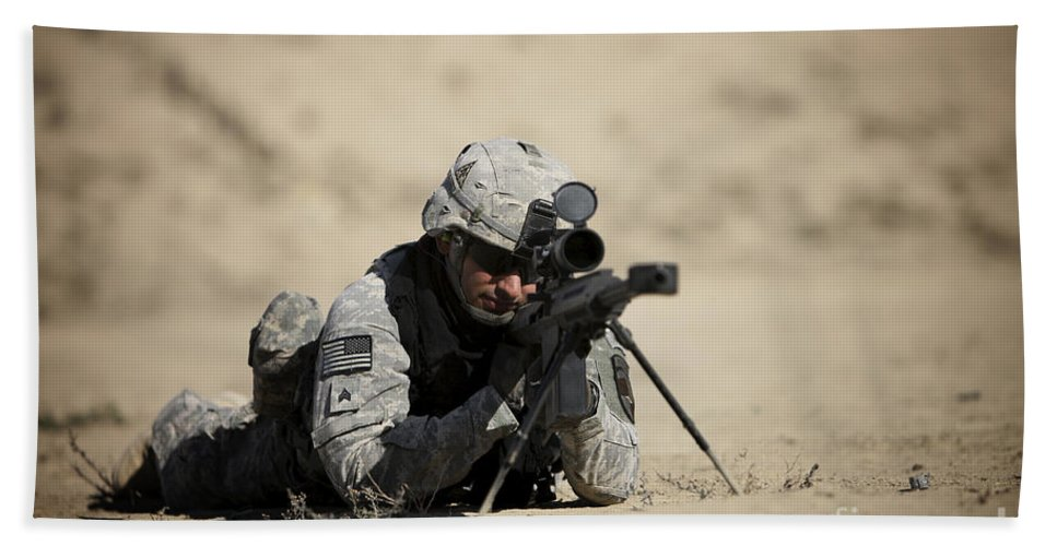 Operation Enduring Freedom Beach Towel featuring the photograph U.s. Army Soldier Sights In A Barrett by Terry Moore
