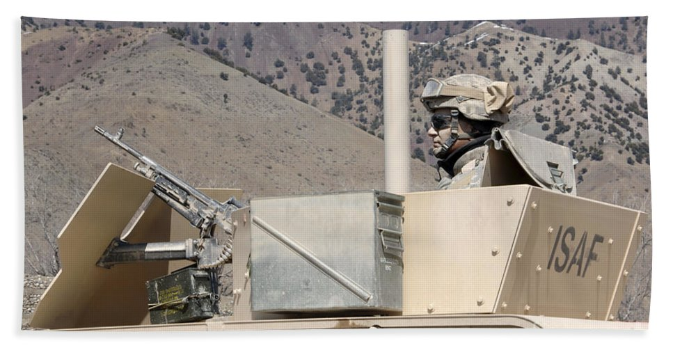 Afghanistan Beach Towel featuring the photograph U.s. Army Specialist Scans His Sector by Stocktrek Images