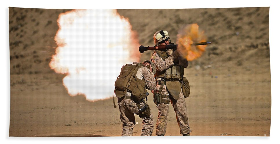 Operation Enduring Freedom Beach Towel featuring the photograph U.s. Marine Fires A Rpg-7 Grenade by Terry Moore