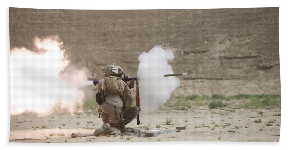 Desert Beach Towel featuring the photograph U.s. Marines Fire A Rpg-7 Grenade by Terry Moore