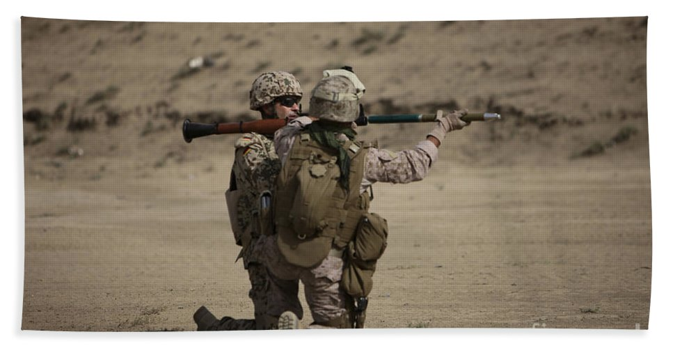 Fragmentation Beach Towel featuring the photograph U.s. Marines Load A Fragmentation Round by Terry Moore