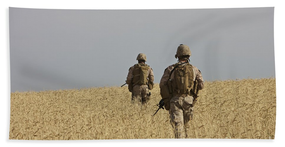 Afghanistan Beach Towel featuring the photograph U.s. Marines Patrol A Wadi Near Kunduz by Terry Moore