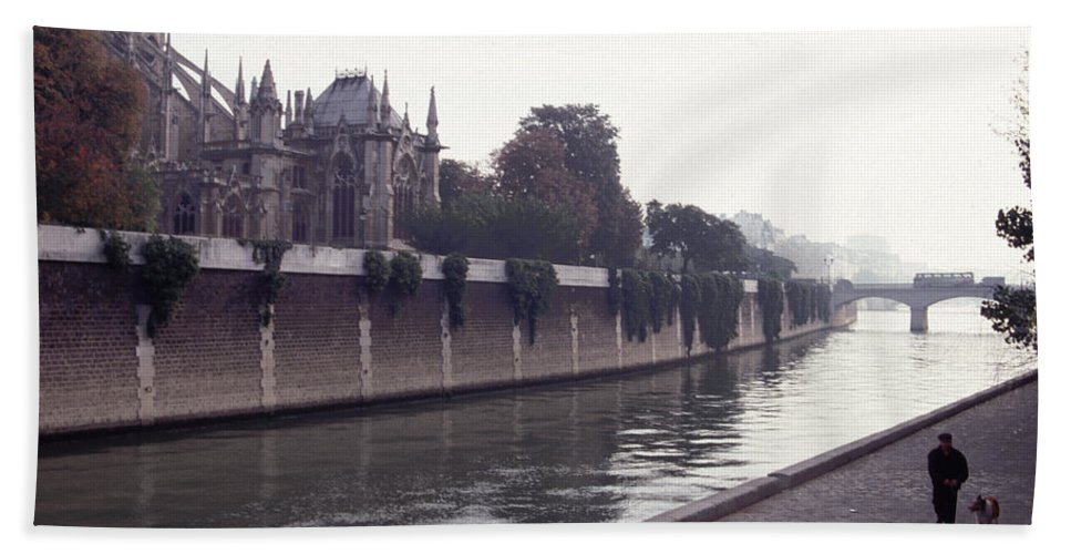 Paris Beach Towel featuring the photograph Walking The Dog Along The Seine by Tom Wurl
