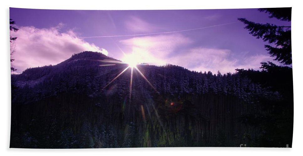 Beach Towel featuring the photograph Winter Sun Winking Over The Mountains by Jeff Swan