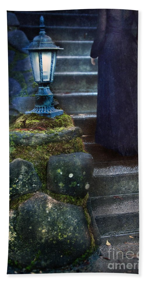 Woman Beach Towel featuring the photograph Woman In Dark Gown On Old Staircase by Jill Battaglia