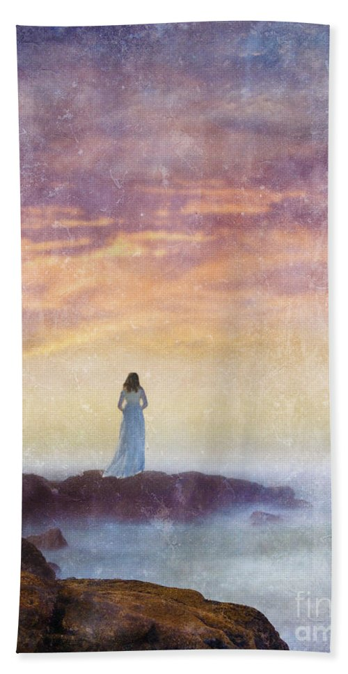 Woman Beach Towel featuring the photograph Woman In Vintage Dress At The Rocky Shore At Dawn by Jill Battaglia