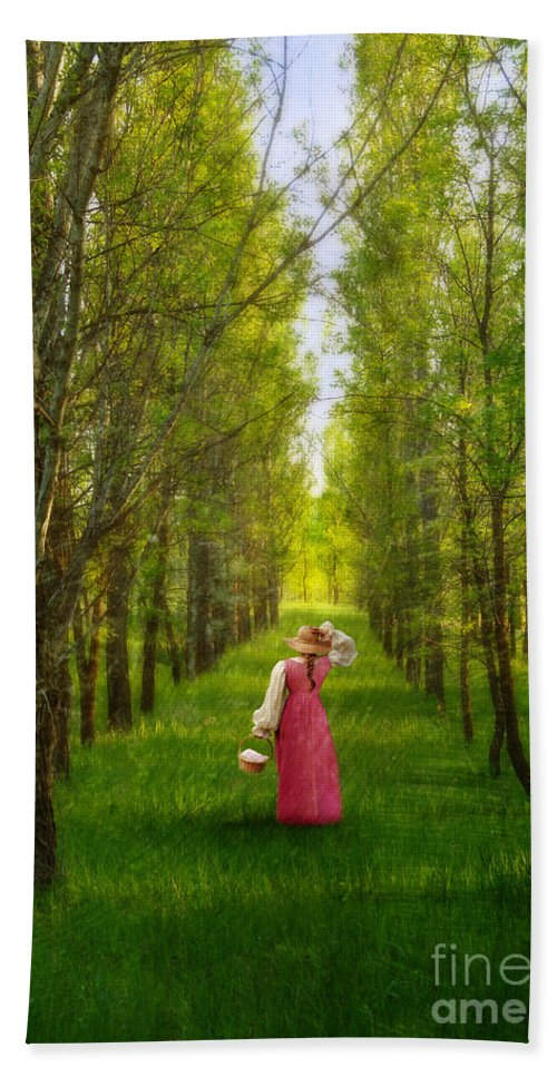 Woman Beach Towel featuring the photograph Woman In Vintage Pink Dress Walking Through Woods by Jill Battaglia