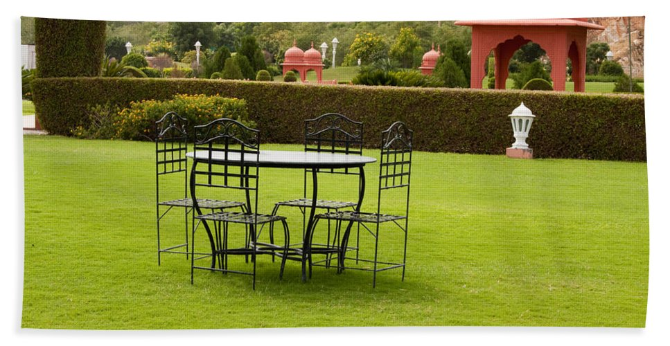 India Beach Towel featuring the photograph Wrought Metal Chairs Around A Table In A Lawn by Ashish Agarwal