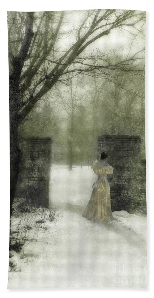 Young Beach Towel featuring the photograph Young Lady By Stone Pillar In Snow by Jill Battaglia