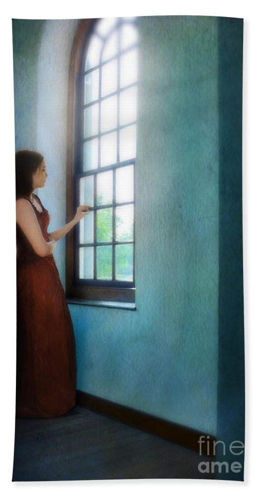 Beautiful Beach Towel featuring the photograph Young Lady Looking Out Window by Jill Battaglia