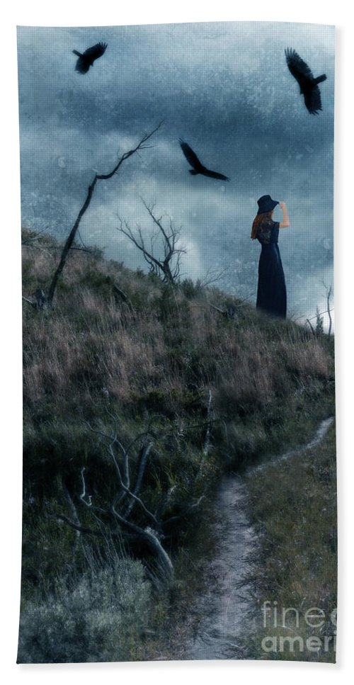 Landscape Beach Towel featuring the photograph Young Woman On Creepy Path With Black Birds Overhead by Jill Battaglia