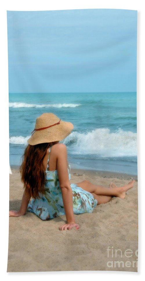 Woman Beach Towel featuring the photograph Young Woman Sitting On A Beach by Jill Battaglia