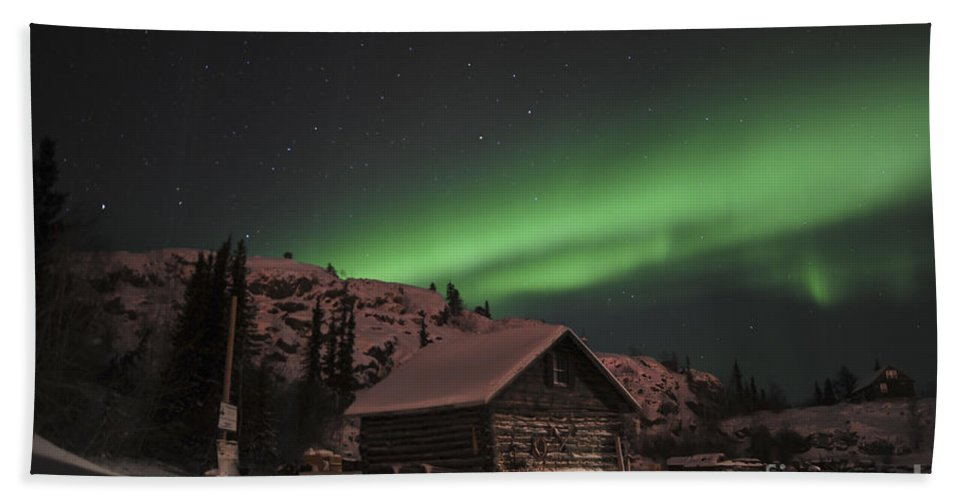 Yellowknife Beach Towel featuring the photograph Aurora Borealis Over A Cabin, Northwest by Jiri Hermann