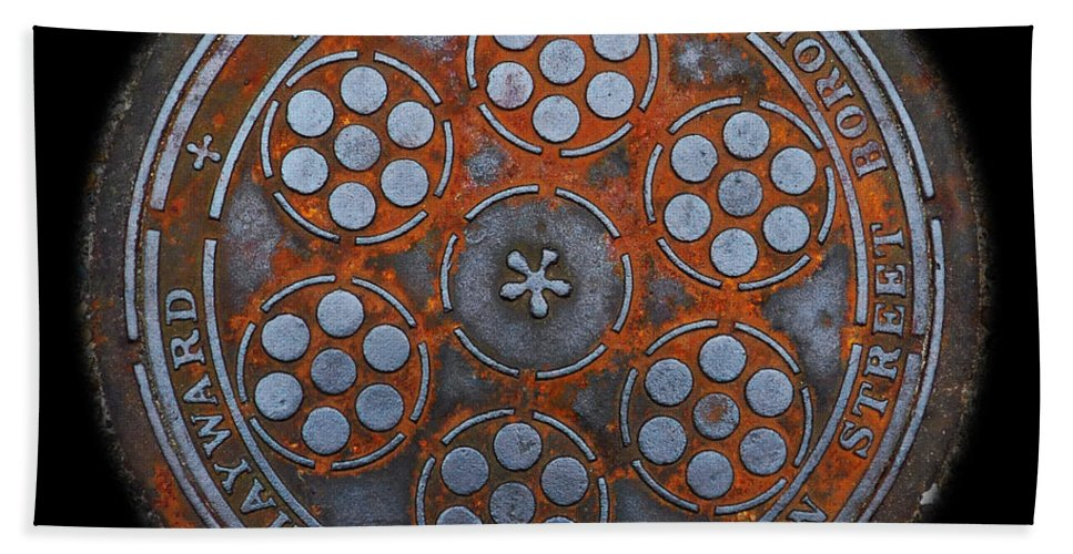 Manhole Beach Towel featuring the photograph Shield by Charles Stuart