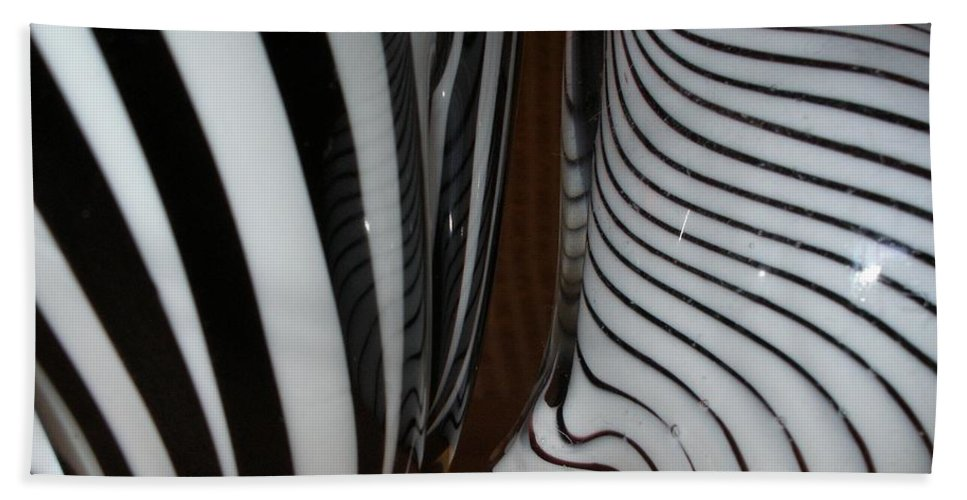 Blac Beach Towel featuring the photograph Zebra Glass by Maria Bonnier-Perez