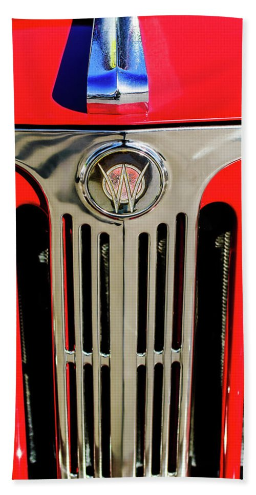 1949 Willys Jeepster Grille Beach Towel featuring the photograph 1949 Willys Jeepster Hood Ornament And Grille by Jill Reger