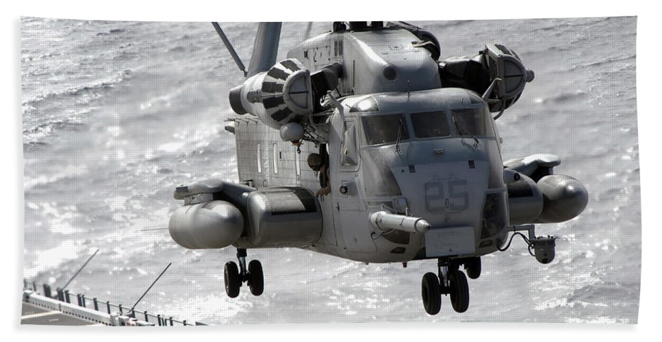 Helicopter Beach Towel featuring the photograph A Ch-53e Super Stallion Helicopter by Stocktrek Images