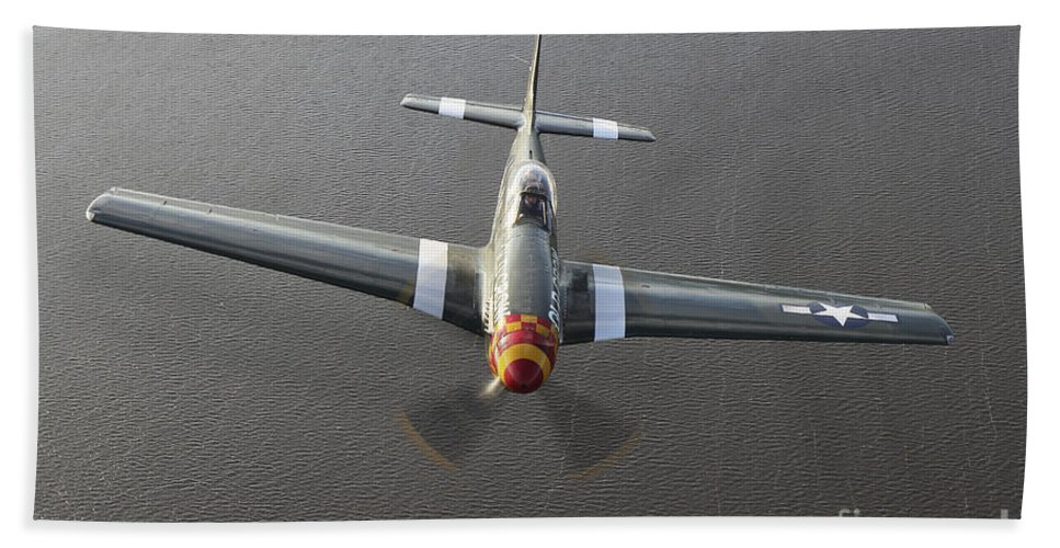 Warplane Beach Towel featuring the photograph A North American P-51 Mustang In Flight by Daniel Karlsson