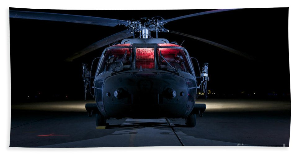 Operation Iraqi Freedom Beach Towel featuring the photograph A Uh-60 Black Hawk Helicopter Lit by Terry Moore