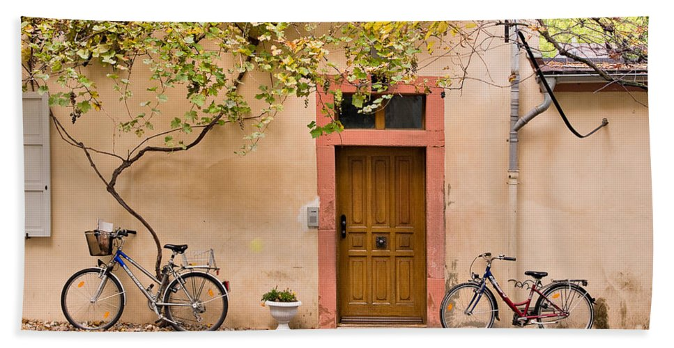 Travel Beach Towel featuring the photograph A Back Lane In Speyer by Louise Heusinkveld
