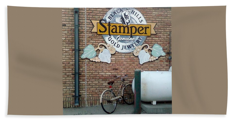 Bicycle Sign Rain Gutter Bricks Beach Towel featuring the photograph A Parked Bicycle by Cindy New