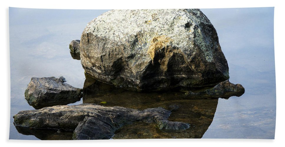 Rock Beach Towel featuring the photograph A Rock In Still Water by Richard Henne