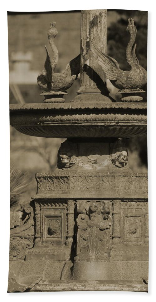 Aged Beach Towel featuring the photograph Aged And Worn Swan Statues On Rustic Cast Fountain by Colleen Cornelius