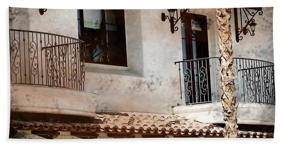 Aged Photograph Beach Towel featuring the photograph Aged Stucco Building Balcony with Terracotta Roof by Colleen Cornelius