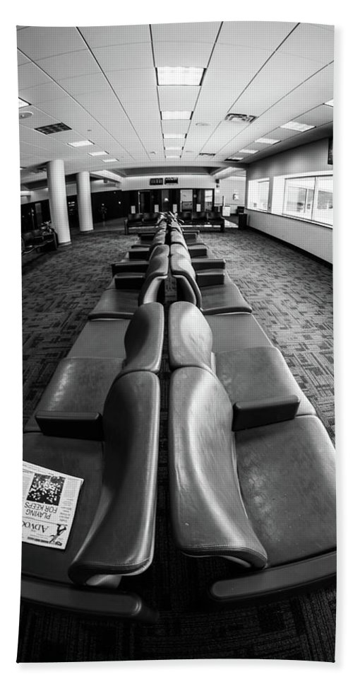 Artisans Beach Towel featuring the photograph Alone At The Airline Gate by Cary Leppert