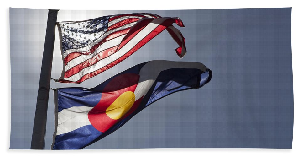 American Beach Towel featuring the photograph American And Colorado Flags by Lori Werhane