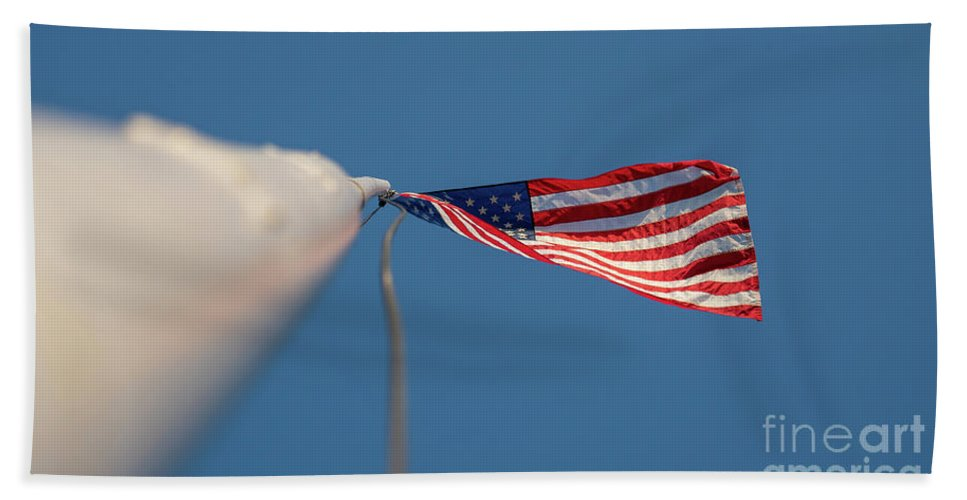 Usa Beach Towel featuring the photograph American Flag At The End Of Tall Post With Blue Skies by PorqueNo Studios