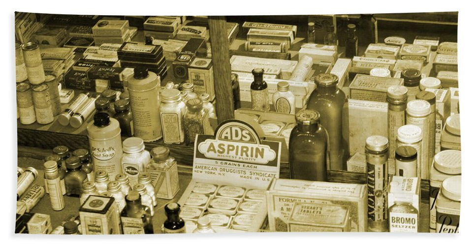 Ruddy's General Store Beach Towel featuring the photograph Aspirin In Sepia by Colleen Cornelius