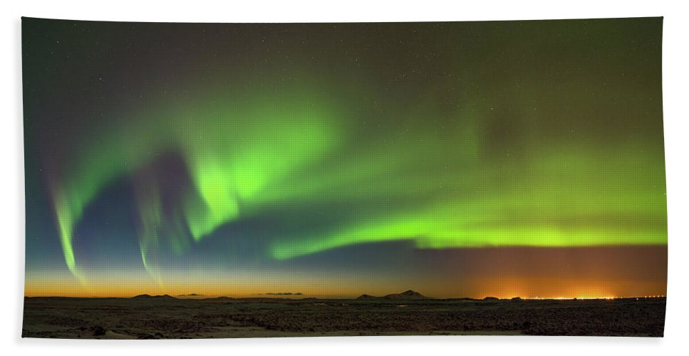 Iceland Beach Towel featuring the photograph Aurora Above Keflavik In Iceland. by Andy Astbury