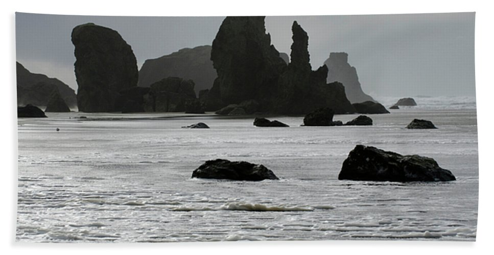 Rocks Beach Towel featuring the photograph Bandon Silouettes by Bob Christopher