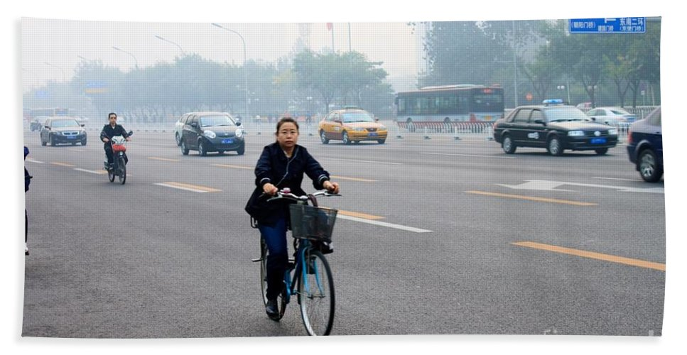 Bicycle Beach Towel featuring the photograph Bicyclist In Beijing by Thomas Marchessault