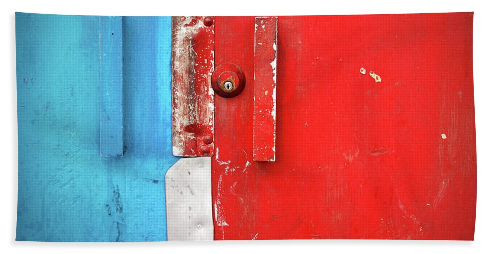 Urban Beach Towel featuring the photograph Blue Wall Red Door by Tara Turner