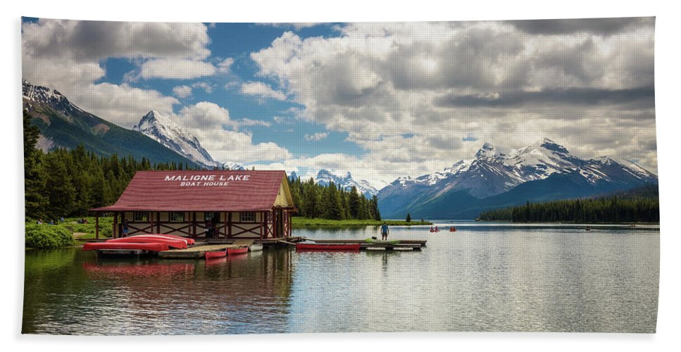Alberta Beach Towel featuring the photograph Boat House And Canoes On A Jetty At Maligne Lake In Canada by Miroslav Liska
