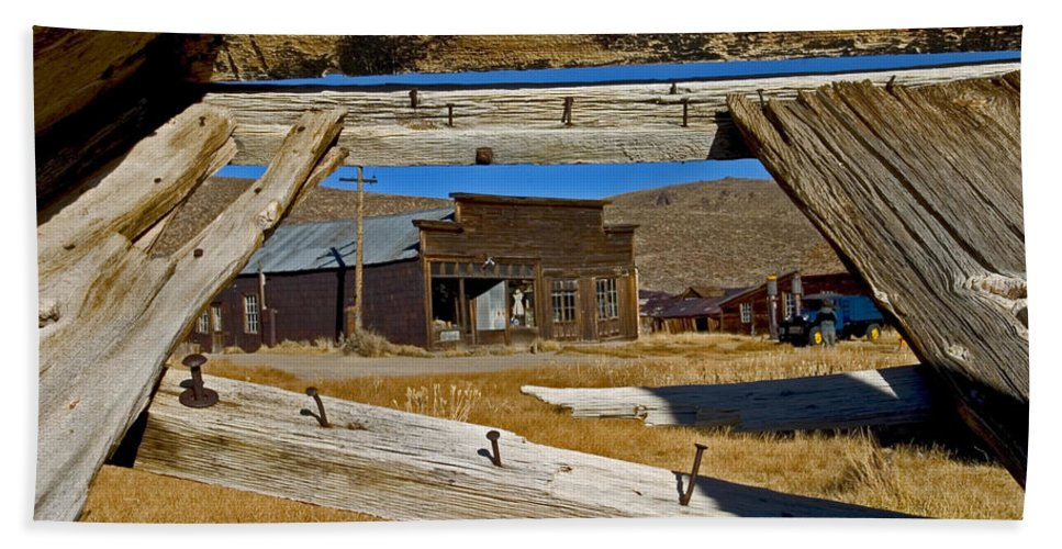 Bodie State Park Beach Towel featuring the photograph Bodie Through Buckboard by David Salter